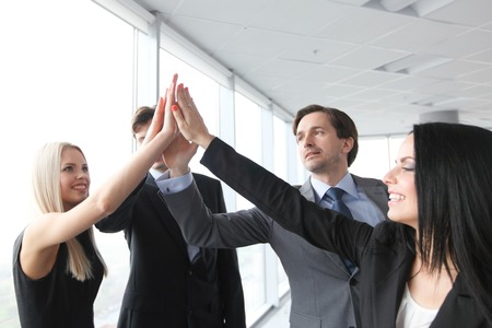 high five: Happy business people hands giving high five