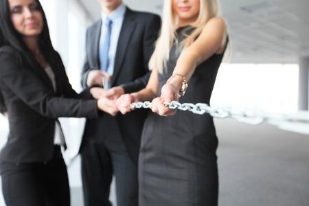 teamwork concept: Businessmen pulling chain, teamwork togetherness concept Stock Photo