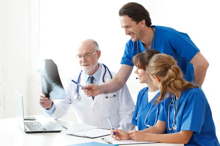 team of doctors looking at x-ray