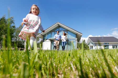 outside of house: happy family running from the house Stock Photo