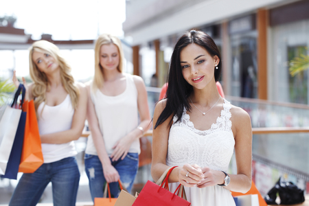 lifestyle shopping: Young beautiful happy women with shopping bags in mall