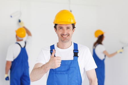 two thumbs up: workman gives thumbs up in front of two painters
