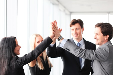 business results: Happy business people hands giving high five