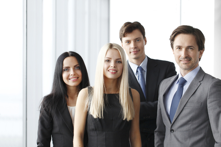 manager team: Happy business team of coworkers in office Stock Photo
