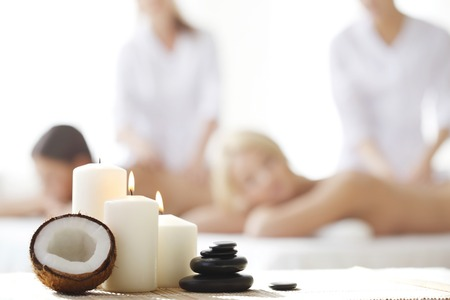 herbal massage ball: Spa massage tools and women getting massage on background