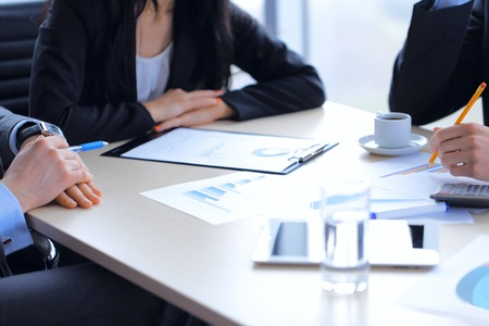 Accountant: Business people discussing financial reports during a meeting
