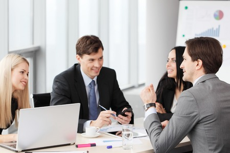 team work: Business people analyzing financial reports in office Stock Photo