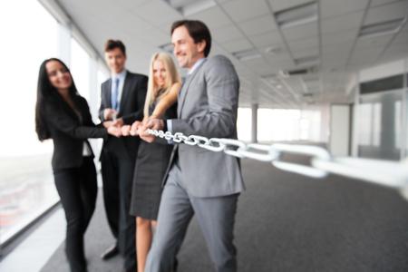 togetherness: Businessmen pulling chain, teamwork togetherness concept Stock Photo