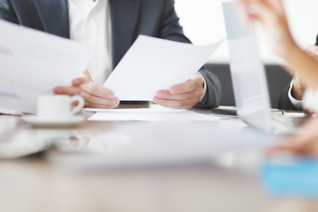 Close-up of Business people working together at a meeting