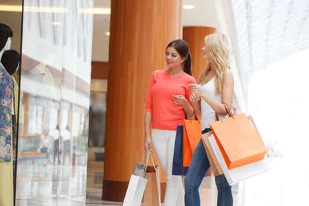 woman bag: Young beautiful happy women with shopping bags in mall