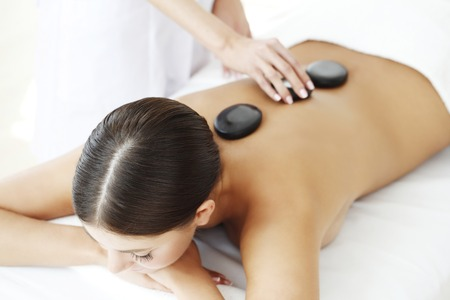hot stone: Girl on a stone therapy, hot stone massage