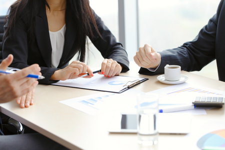 financial plan: Business people discussing financial reports during a meeting