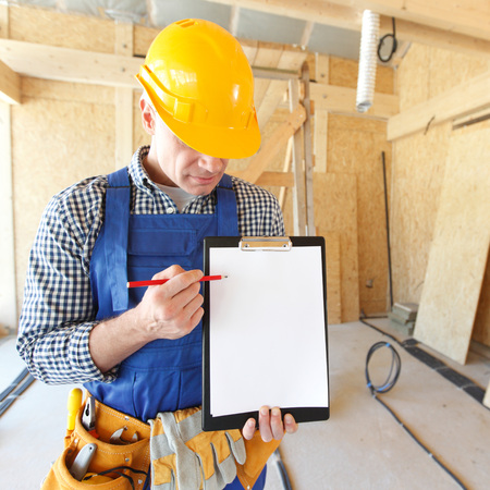 foreman: Portrait of foreman pointing at white folder plate Stock Photo
