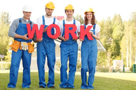workmen: Group of workmen with word work outdoors