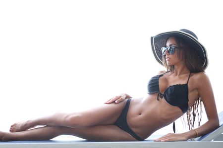chaise lounge: Fashion woman in bikini rest on chaise lounge
