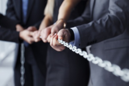 group chain: Businessmen pulling chain, teamwork togetherness concept Stock Photo
