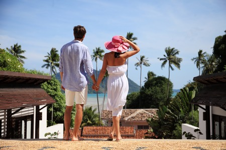 tourist resort: Young couple look at tourist resort and sea Stock Photo
