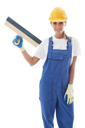 handywoman: Young beautiful handywoman with masonry trowel isolated on white