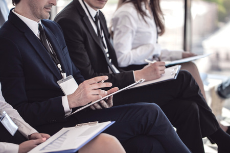Business group of people making notes during a meeting conference Stock Photo