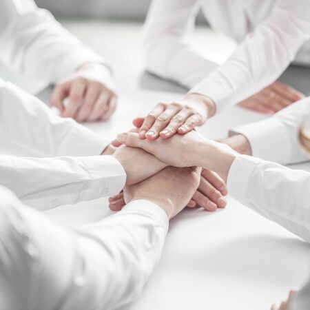 joining hands: Business people joining hands in stack close up view Stock Photo