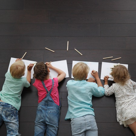 painting drawings: Group of cute children drawing with colorful pencils on floor