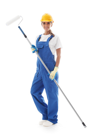 handywoman: Young beautiful handywoman with paint roller isolated on white Stock Photo