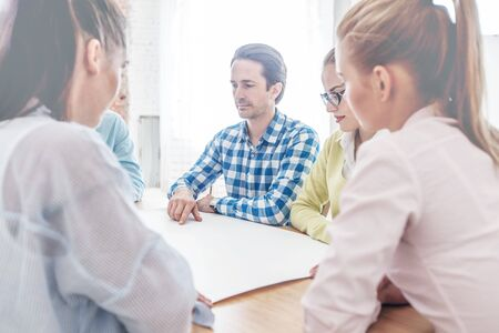 Business team of people in casual talking at meeting table