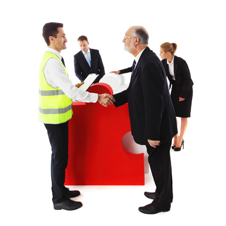 recieving: Group of business people recieving jigsaw puzzle of business isolated on white background Stock Photo