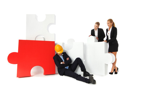foreman: Coworkers look at tired foreman sleeping near puzzle isolated on white background