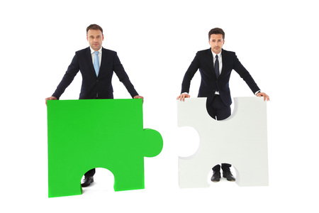compatibility: Business people with puzzle peices isolated on white background, business compatibility concept