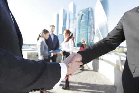 finalized: Business handshake, the deal Is finalized by group of people outside