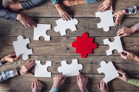 Hipster business successful teamwork concept, business group assembling jigsaw puzzle Stock Photo