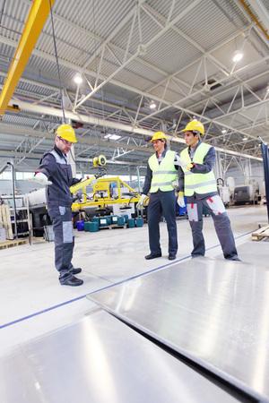 billet: Workers near aluminium billet at CNC machine shop Stock Photo