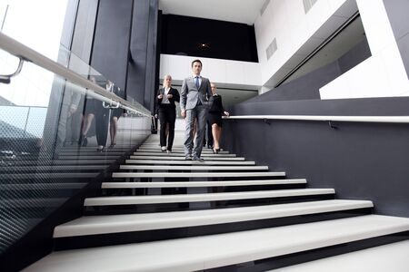 collaborators: Business people walking down the steps of stairs