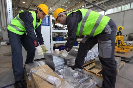 aluminium: Workers taking aluminium billet at CNC machine shop