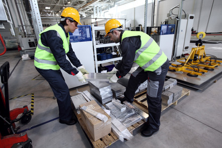 billet: Workers taking aluminium billet at CNC machine shop