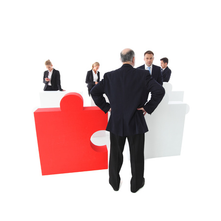 Confused shocked, surprised worker apologizes to manager, part of puzzle team concept, isolated on white Stock Photo