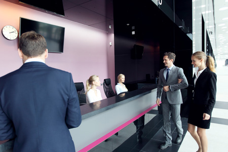 Business people at front desk of airport or modern office building Stock Photo