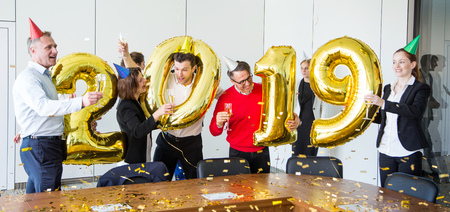 Business people celebrating 2019 New Year at office party