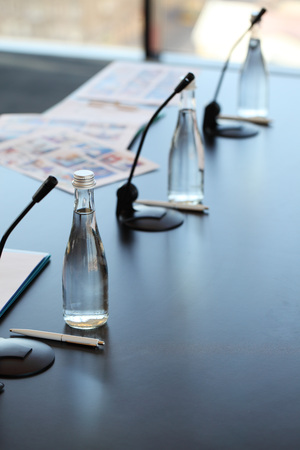Conference room table for business meeting with microphones and bottles of water Banco de Imagens