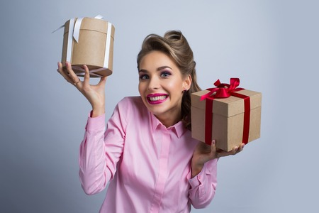 Young happy woman holding two presents with bows Banque d'images