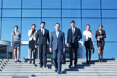 Team of diverse business people at stairs of company office building