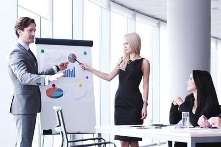 Business presentation in office , spreaker showing reports at whiteboard Stock Photo