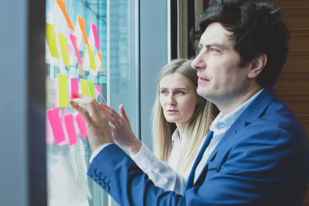 Group of business people brainstorming ideas. Entrepreneurs having a standing meeting discussing ideas strategy planning problem solution concept Stock Photo