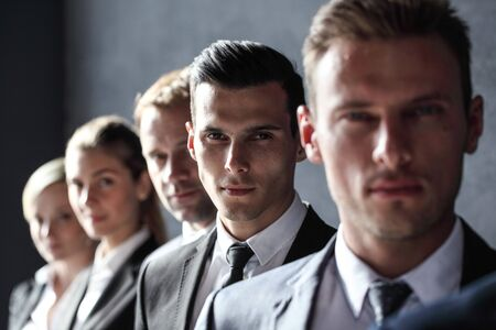 Group of business people standing in a row