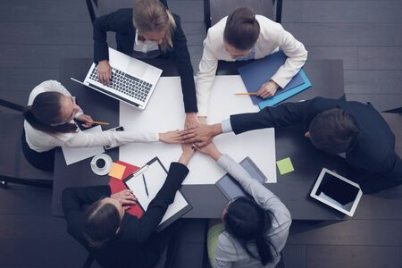 People with their hands together, stacking hands. Business team work concept Stock Photo