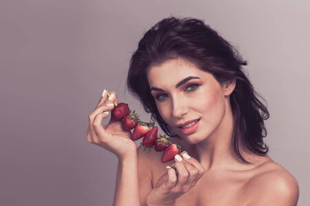 Woman with strawberry dessert fruit smiling healthy and joyful