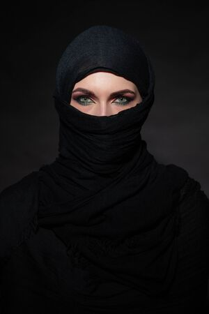 Portrait of beautiful muslim woman in black hijab 写真素材