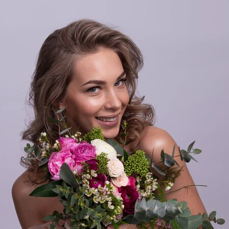 Beautiful woman with bouquet of flowers gift for valentines day