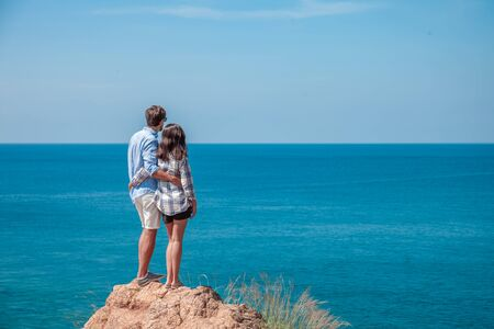 Young couple enjoy beautiful sea view on vacation